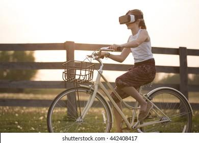 Girl riding a bike wearing a VR headset