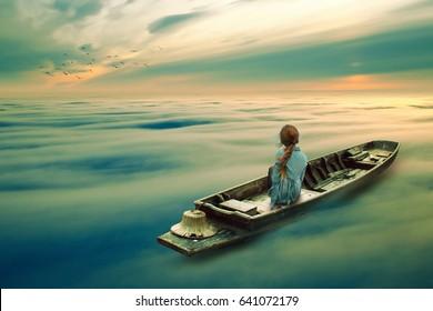 girl riding boat in a mist ocean