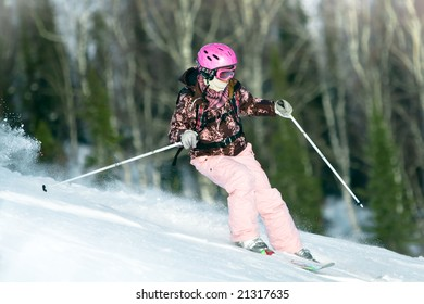 Girl riding fast on skis