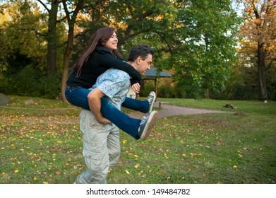 A girl riding her boy