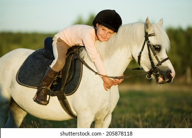 Girl riding a horse on nature