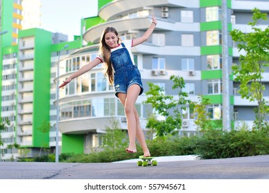 a girl riding on a skateboard in spring and summer