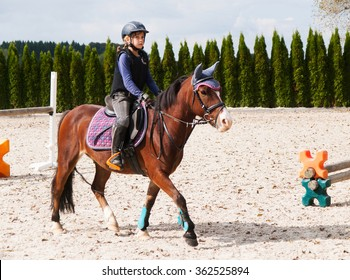 Girl riding on sport pony