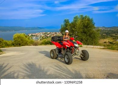 Girl riding quad on the island