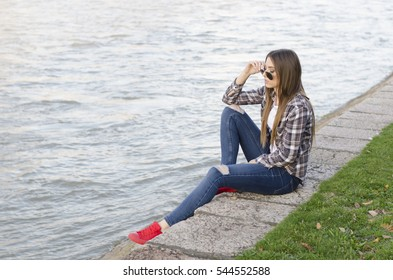 Girl  with river in background