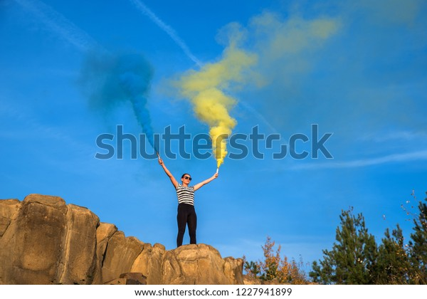 Girl Rocks Colored Smoke Bombs Against Stock Photo (Edit Now) 1227941899
