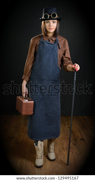The girl in a role of craftsman with a cane and a tool box