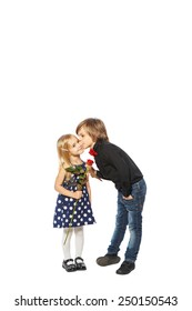 Girl with a rose in her hand standing near the boy on a white background