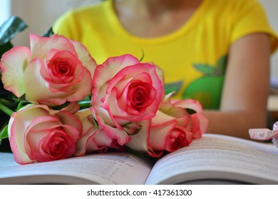 girl, roses and book