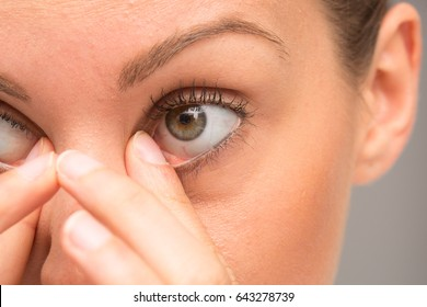 Girl rubbing her eyes
