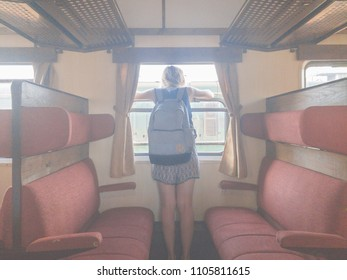 Girl with rucksack inside the old retro wagon.