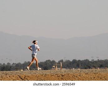 Girl Running Along Dirt Path