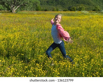 Girl running in the flower meadow