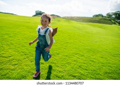Girl running in the meadow