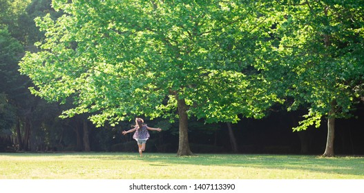 Girl running in the meadow barefoot