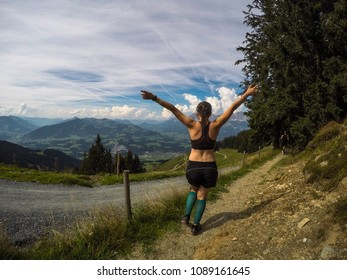 Girl running Obstacle Course Racing in the Montains . Outdoor activities. Exercising and workout.