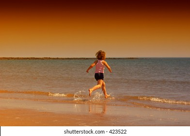 girl running on the beach, early evening, scotland, summer 2005