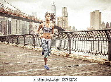 Girl running on the pier with New york skyline in the background