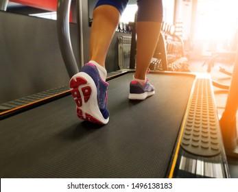 girl running on a treadmill