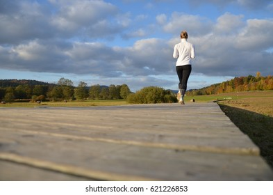 girl running on the wooden pavement