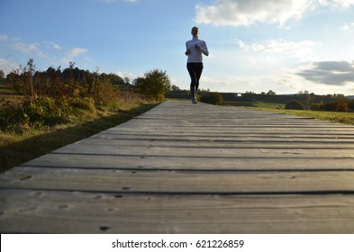 girl running up on the wooden pavement