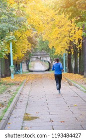 Girl running in a park