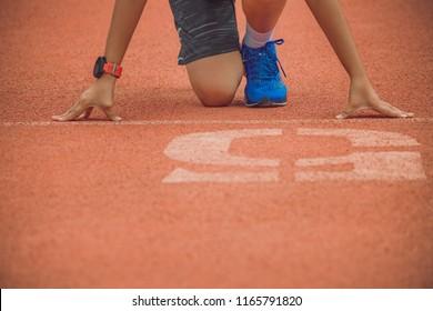 Girl running She wears sportswear Blue running shoes And black shorts.