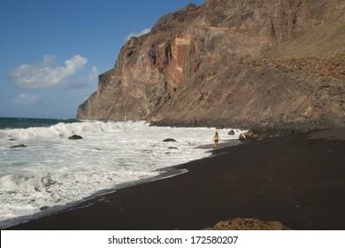 "Girl is running through the coast line on ""Playa del Ingles"", Valle Gran Rey, La Gomera, Spain"
