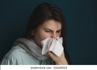 the girl with the runny nose, isolated on cyan background