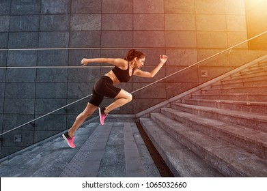 Girl runs fast on a modern stair