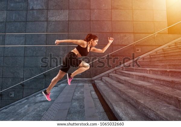 Girl runs fast on a modern stair