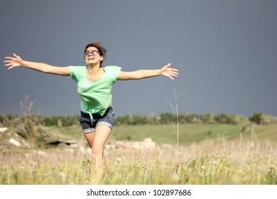 The girl runs on a grass