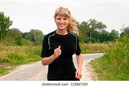 girl runs on road