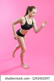 girl runs, roses background, pink