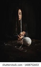 The girl is sad in the dark room