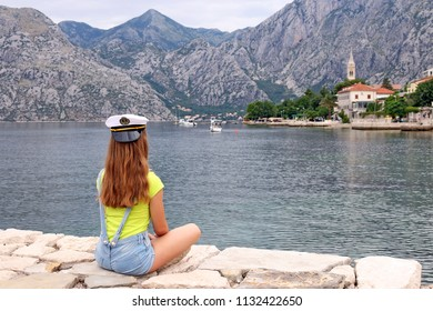 girl with sailor hat on summer vacation Kotor bay Montenegro