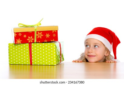 girl with Santa- cap in anticipation for christmas