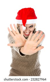 Girl in Santa hat showing hands stop. Isolated on a white background