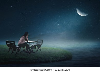 The girl sat on the back of a lonely heart on a chair in the moon creaking on a beautiful grass island.