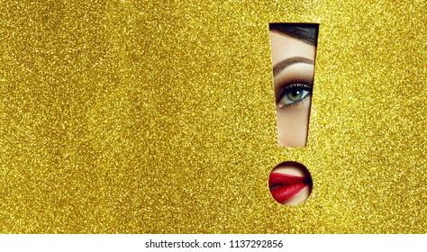 The girl says - attention!A girl with beautiful puffy lips, painted in red lipstick with a metallic effect. Lips in the pit in the form of an exclamation mark of golden shiny paper.