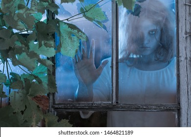 girl scary  ghost in the old window