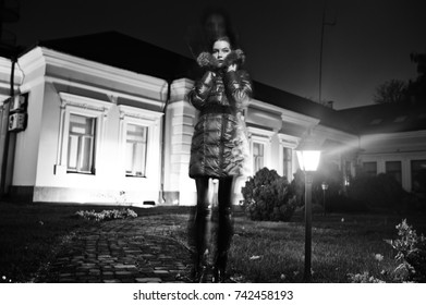 Girl at scary mansion. Blured freeze motion. Halloween theme.