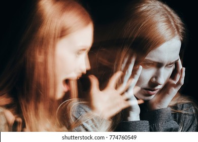 Girl with schizophrenia covering her ears to not hear the voice of her alter ego. Blurred person
