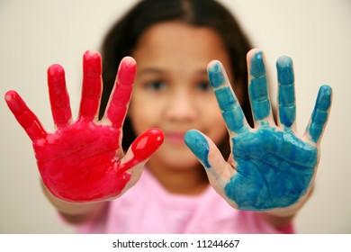 Girl at school finger painting