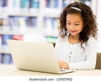 Girl at school using a laptop cpmputer