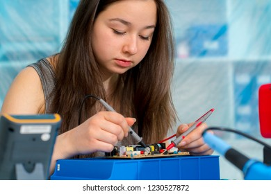 Girl schoolgirl in the classroom in the laboratory of robotics and electronics