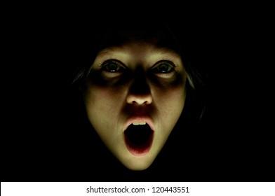 girl screams in fright in the dark