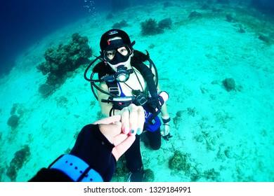 girl scuba diving