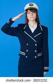The girl in a sea uniform salutes