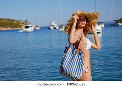 girl at the seaside. Adriatic, yachts in the background